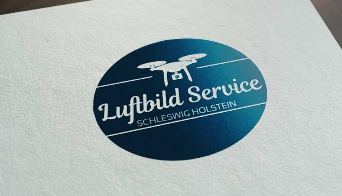 Mockup von dem Luftbild Service SH Logo in Blau auf weißem Papier