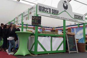 Der Messestand von Watt'n Senf in grün und weiß gestaltet