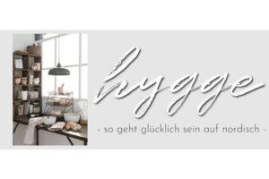 Slider mit einem Bild einer Küche und den worten hygge - so geht glücklich sein auf nordisch